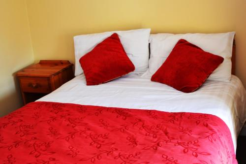 A bed or beds in a room at Church View Guest House