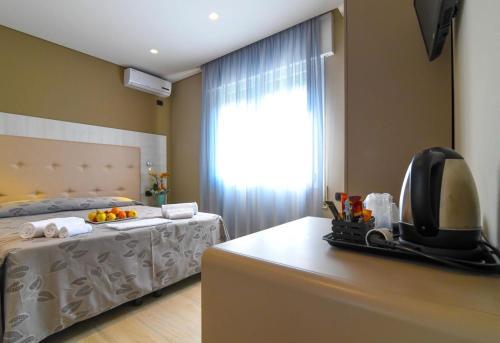 Postel nebo postele na pokoji v ubytování Hotel Ristorante Fortuna