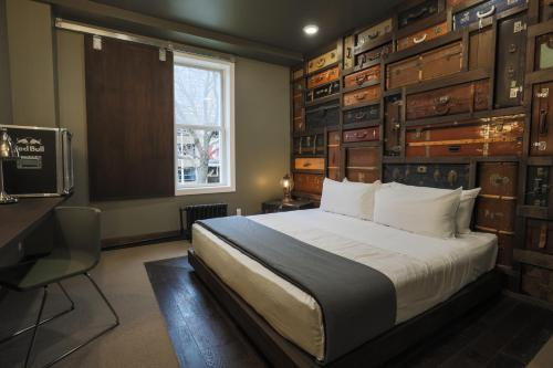 A bed or beds in a room at Crash Hotel Downtown Edmonton