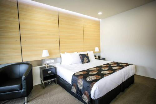 A bed or beds in a room at Room Motels Gatton