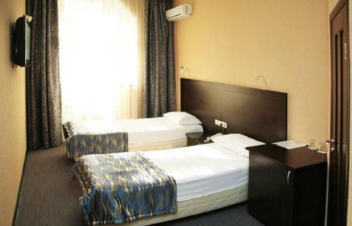 Кровать или кровати в номере Отель Регина Университетская