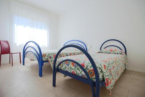 Postel nebo postele na pokoji v ubytování Residence Braida