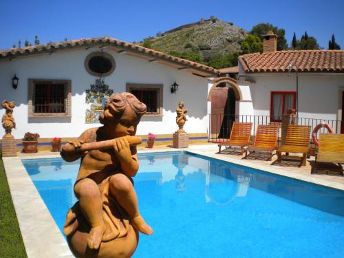 The swimming pool at or near La Estancia Villa Rosillo