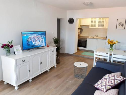 A television and/or entertainment centre at Amore