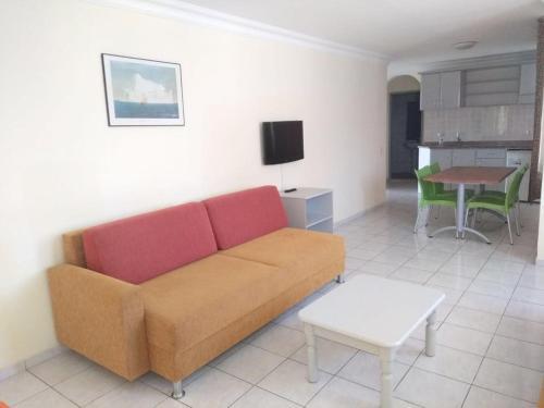 Ein Sitzbereich in der Unterkunft Sailor Apart Hotel