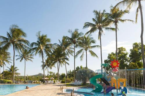 The swimming pool at or near Flamboyant Hotel & Convention