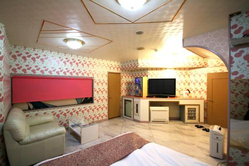 ホテルニュー十色(大人専用)にあるテレビまたはエンターテインメントセンター