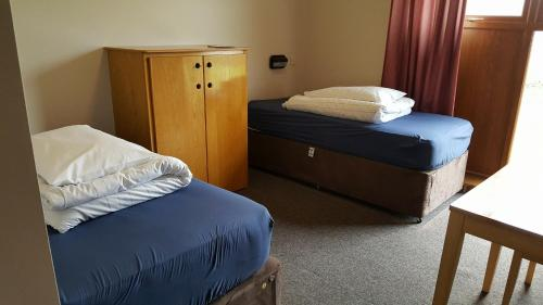A bed or beds in a room at Errigal Youth Hostel