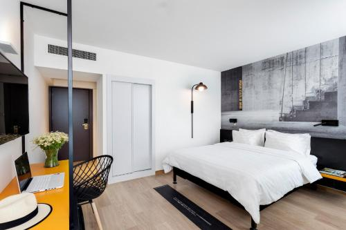 A bed or beds in a room at BY14 TLV Hotel