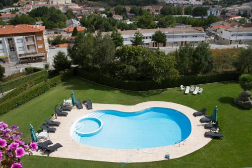 A view of the pool at Hotel Aguiar da Pena or nearby