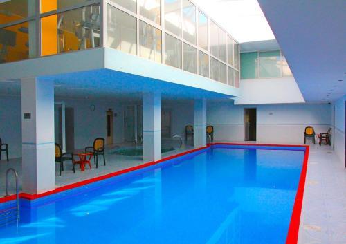 The swimming pool at or near Juna Aqua Life