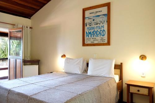 Een bed of bedden in een kamer bij Hotel e Pousada La Dolce Vita
