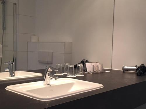 Ein Badezimmer in der Unterkunft Das Goldene Lamm Aalen