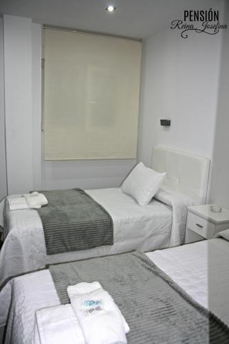 Cama o camas de una habitación en Pension Reina Josefina