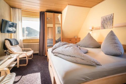 Ein Bett oder Betten in einem Zimmer der Unterkunft Haus Quentin