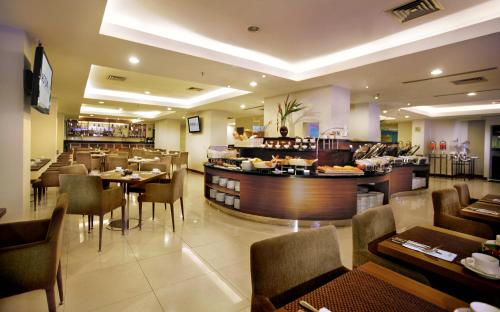 A restaurant or other place to eat at Aston Pluit Hotel & Residence