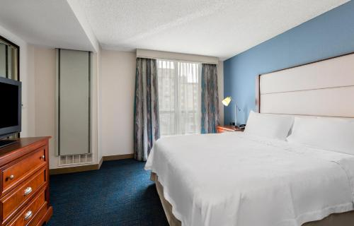 A bed or beds in a room at Homewood Suites by Hilton Seattle Downtown
