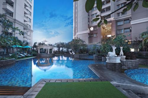 The swimming pool at or near Grand Dafam Ancol Jakarta
