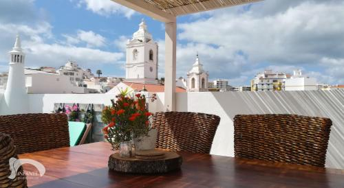 A balcony or terrace at Infante Guesthouse