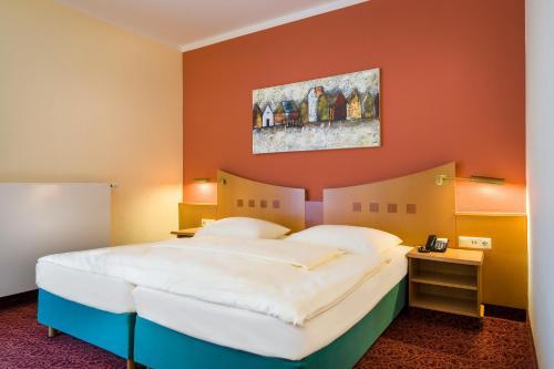 Кровать или кровати в номере Mercure Hotel Ingolstadt