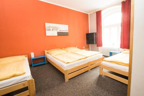 A bed or beds in a room at Hostel Advantage