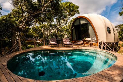 The swimming pool at or near Wild Coast Tented Lodge All Inclusive - Level 1 Safe & Secure
