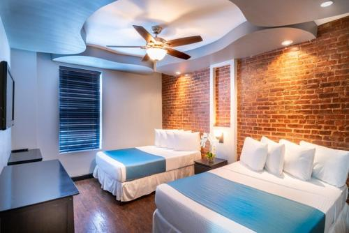 A bed or beds in a room at Broadway Hotel & Hostel