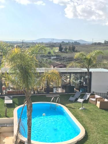 The swimming pool at or near Gallery Basement in Villa Vravrona