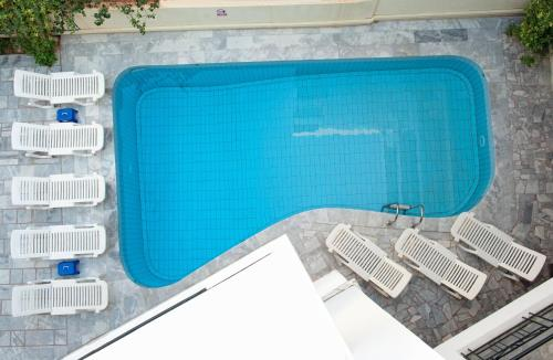 The swimming pool at or near Artemis Hotel Apartments