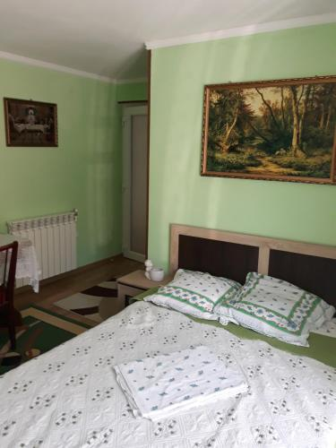 A bed or beds in a room at Casa Papava