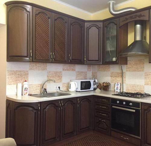 A kitchen or kitchenette at Guest House Na Suvorova