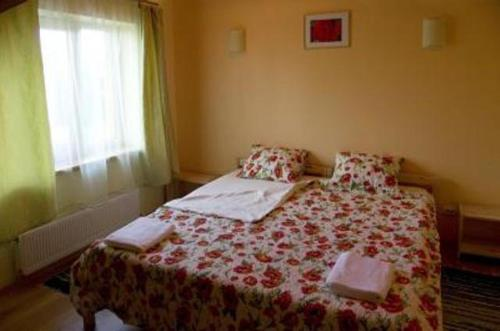 A bed or beds in a room at Guest House Magones