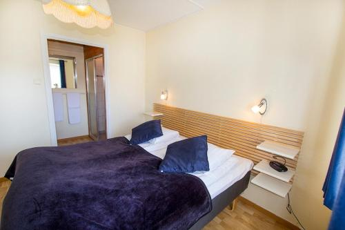 Säng eller sängar i ett rum på Hotel Chaplin