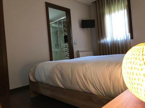 A bed or beds in a room at Casa de Riba'Dao - Arcos de Valdevez