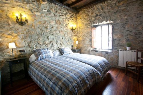 Cama o camas de una habitación en Agroturismo Izarre
