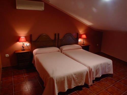 Cama o camas de una habitación en Apartamentos Arquillo