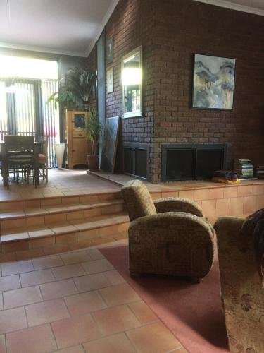 The lobby or reception area at Asimatree B & B and Art Garden