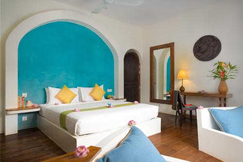 A bed or beds in a room at Navutu Dreams Resort & Wellness Retreat