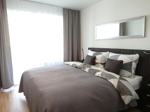 Postel nebo postele na pokoji v ubytování Good Vienna Apartment