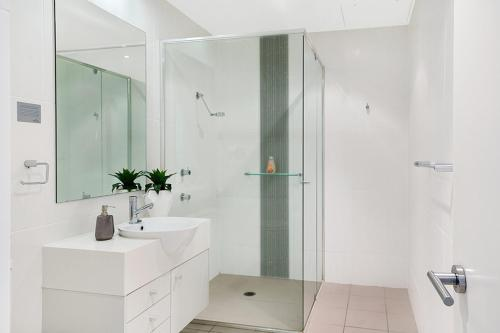 A bathroom at Luxury in Pacific Blue!