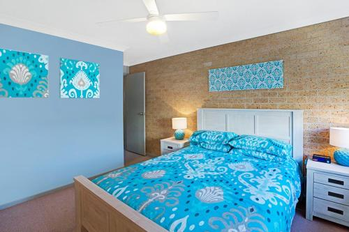 A bed or beds in a room at Close enough to walk to the beach!