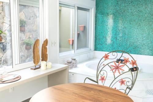 Um banheiro em Hotel Pousada do Bosque