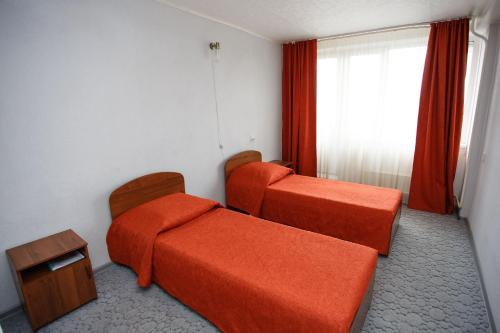 Кровать или кровати в номере Отель Дружба
