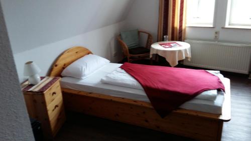 Ein Bett oder Betten in einem Zimmer der Unterkunft Hotel Village