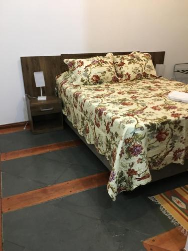 A bed or beds in a room at Pousada Canto dos Pássaros