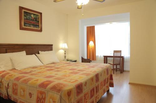 Cama o camas de una habitación en Hotel Casa Gonzalez