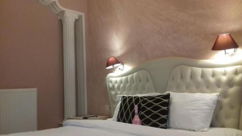 Кровать или кровати в номере Mideia
