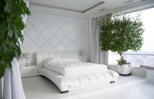 Кровать или кровати в номере Apartment on Konchovskiy