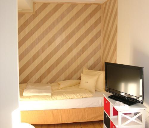 Кровать или кровати в номере Villa Andante Apartmenthotel