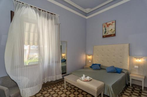 A bed or beds in a room at Hotel Giardino